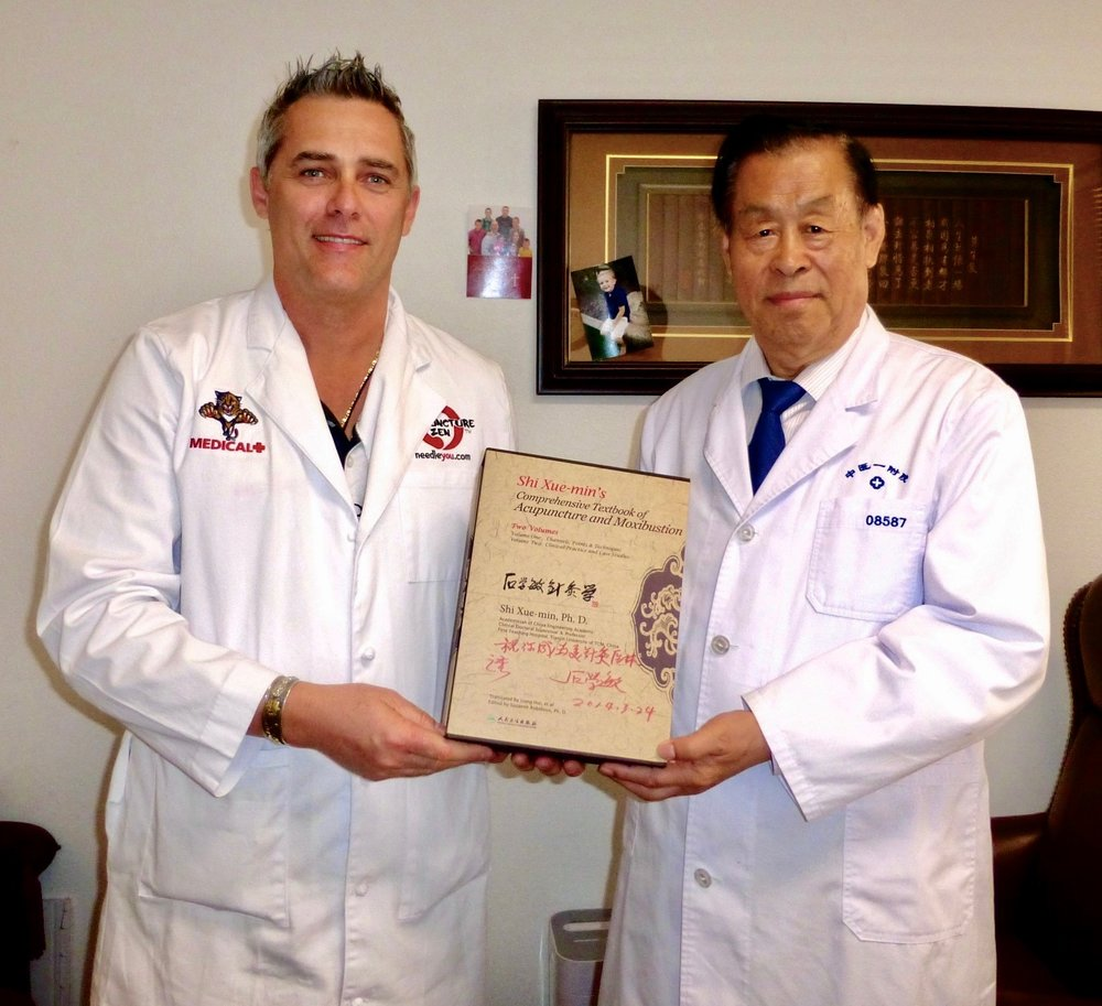 Dr. Tony Willcox having personal tuition with Dr. Shi Xue min of Tianjin, China. Dr. Shi is famous for the documentary 9000 Needles and the developer of a technique called Xing Nad Kai Qiao or XNKQ. This technique is about utilizing scalp and body acupuncture to recover patients post stroke, hemiplagia and other neurological disorders such as dementia and parkinson's disease.