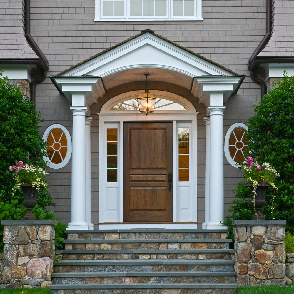 new england style home with connecticut fieldstone entry.jpg