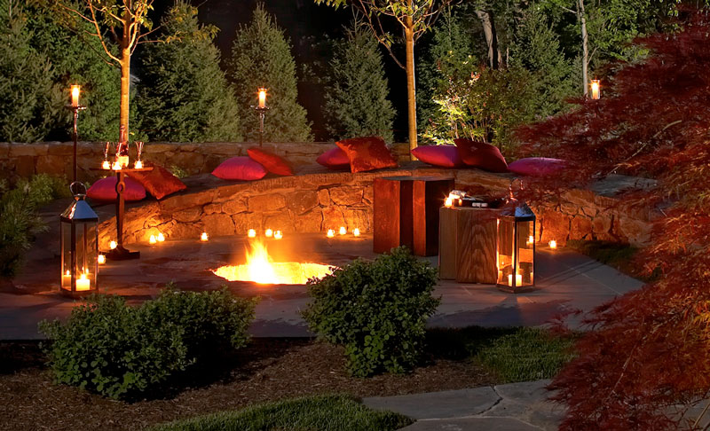 Custom stone firepit at night