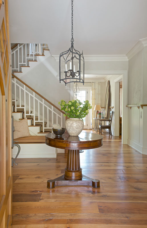 Foyer with reclaimed antique wide plank flooring