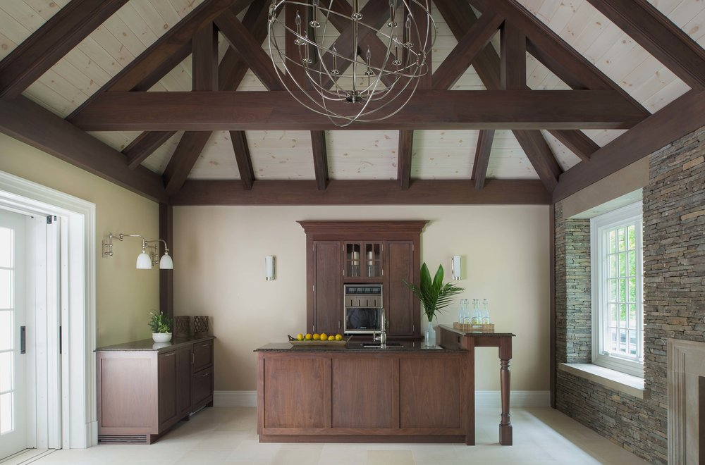 Interior, with custom walnut millwork and beams
