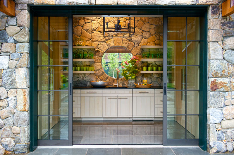 Custom cabinetry in stone pool house