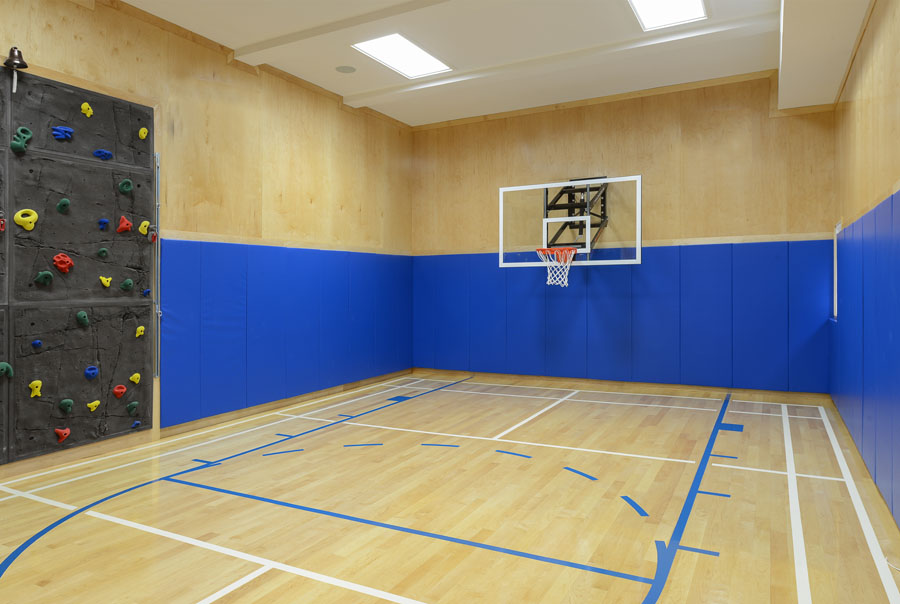 Half-court basketball with badminton & rock climbing wall