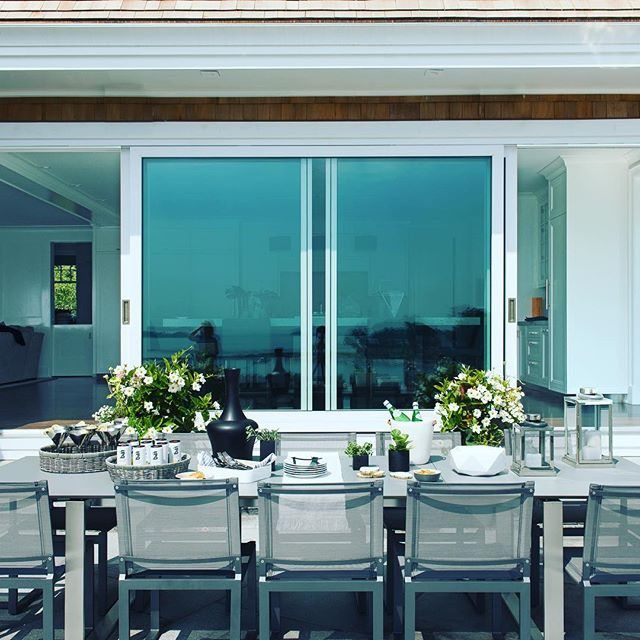 Thoughts of Dining Alfresco in the Warm Weather to come ? Custom large Quantum lift and slide doors open the kitchen to the rear terrace; having a backdrop of the infinity pool and Long Island Sound. Call Richard Rosano for your complimentary consultation for your next home project!203.972.6100 www.rrbuilders.com  #richardrosano #rrbuilders #custombuilder #renovations #additions#liftandslidedoors #infinitypool #warmweather #diningalfresco#longislandsound #newcanaan #connecticut #westchester #florida#naples #palmbeach #awardwinningbuilder  @builders.of.insta @brooksandfalotico @ltutuninteriors @janebeilesphoto @quantumwindows