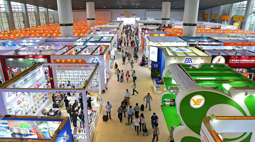 Visitors at the household items pavilion during the 2014 Canton Fair in Guangzhou. The Canton Fair, also known as the China Import and Export Fair, is the largest and longest running trade fair in China, having been held in Guangzhou twice a year since April 1957. The fair brings together over 220,000 vendors and buyers from over 200 countries and regions around the world annually.