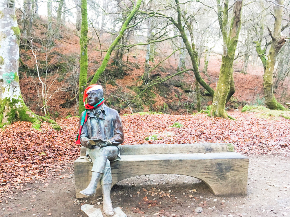 Statue of Robert Burns in the Birks of Aberfeldy. He's in a festive mood...