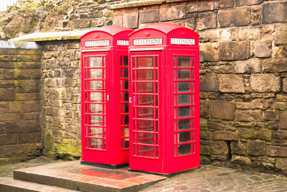 Iconic red telephone booths inside the castle walls