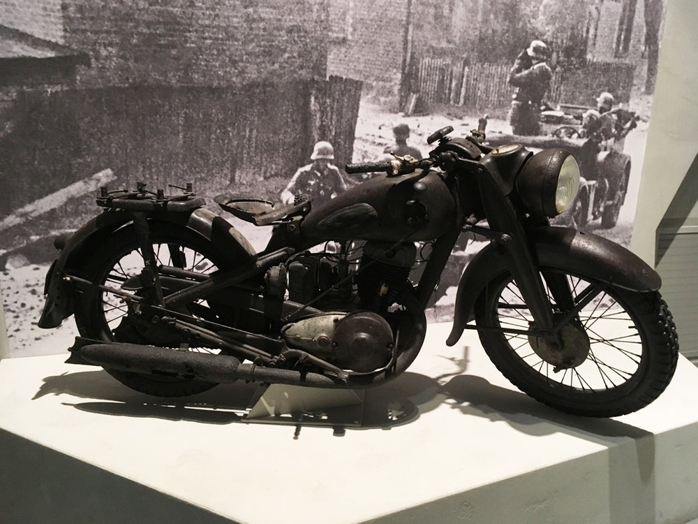 A military motorcycle on display in the museum