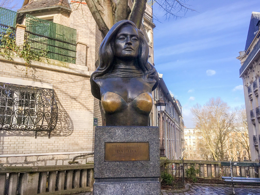 Statue of the famous singer Dalida on Place Dalida. Notice how her boobs are a different colour - it is supposedly good luck to rub them and obviously a lot of people do...