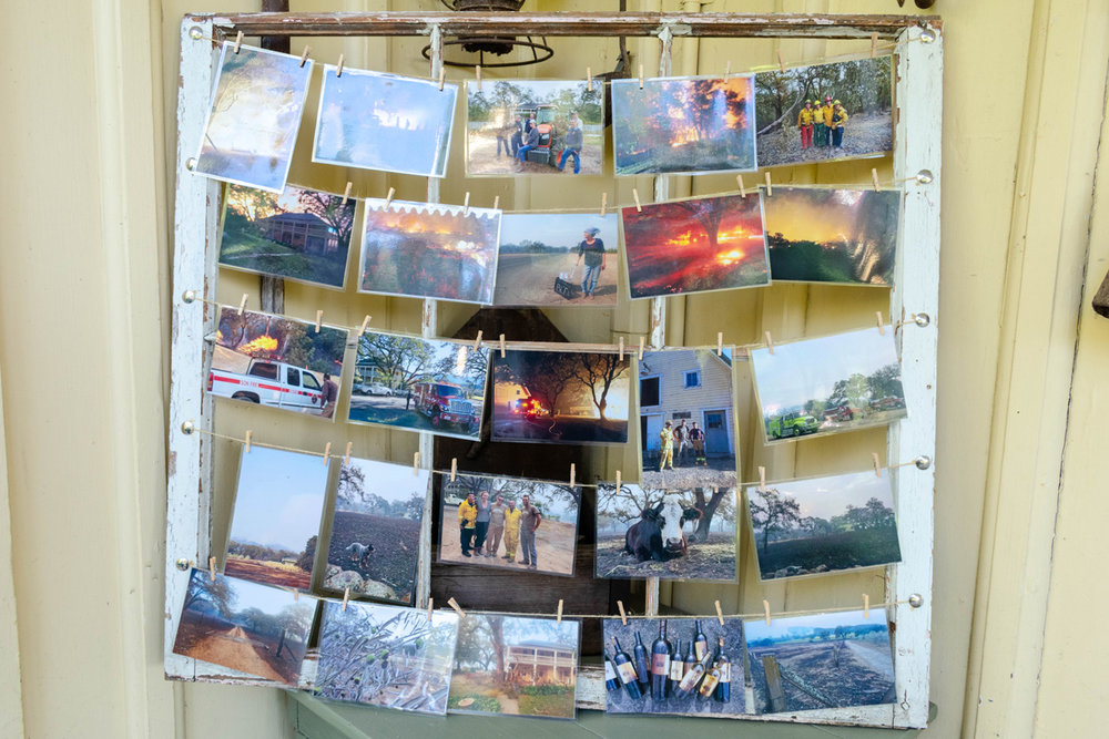 Photos on display of the fire damage at Beltane Ranch