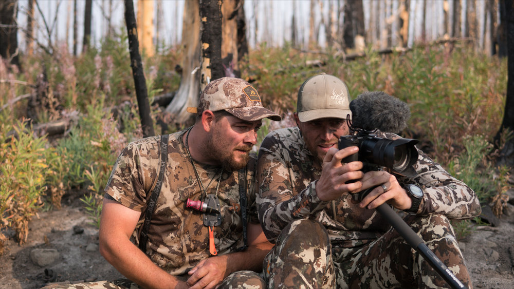 Trent Fisher and Kody Kellom review some of their video footage. Photo by John Abernathy.