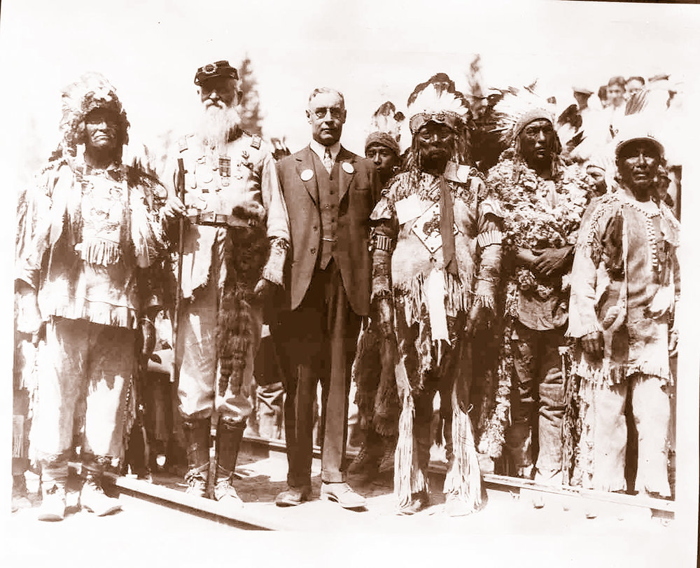 In this 1929 photo, O.C. Applegate (second from left) poses with costumed Native Americans and a railroad official at the opening of Southern Pacific's Modoc line to Klamath Falls.