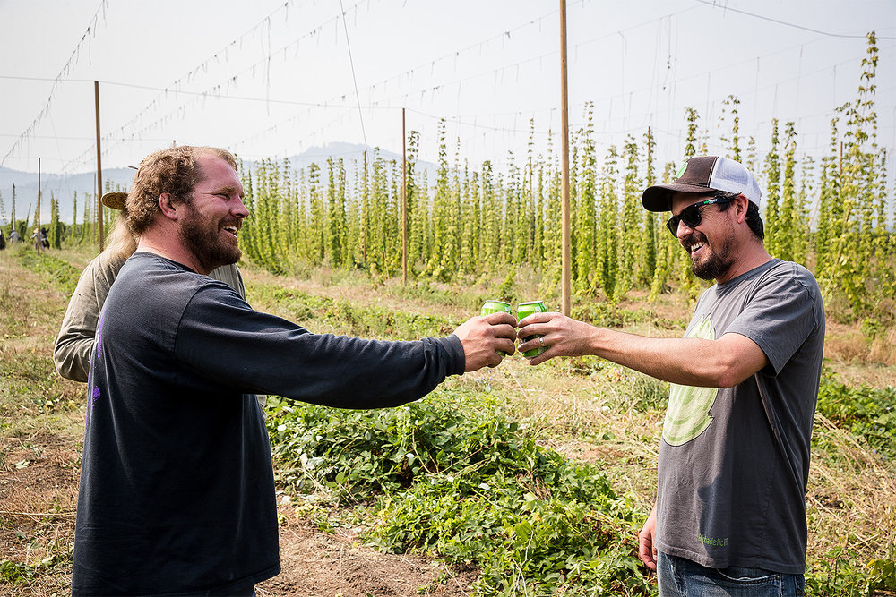 Umpqua Hops owner Cody Parker (left) and Hop Valley brewmasterand co-owner Trevor Howard toast their partnership.