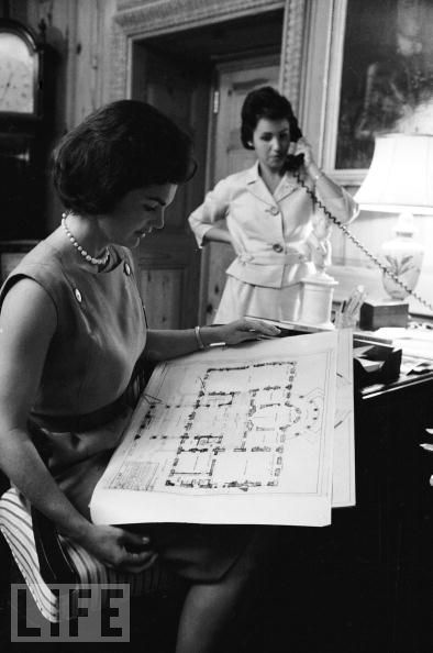 Photo via LIFE: Mrs. Kennedy in the curator's office looking over a blueprint of the mansion.