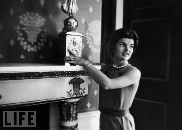 Photo via The Neotrad: Mrs. Kennedy placing a Monroe candlebra