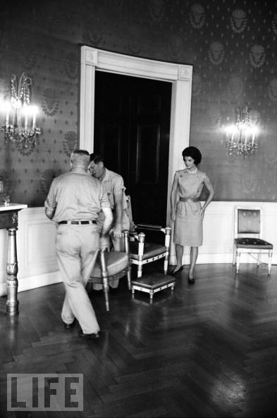 Photo via LIFE: Mrs. Kennedy moving furnishings with federal government maintenance personnel in the Blue Room.