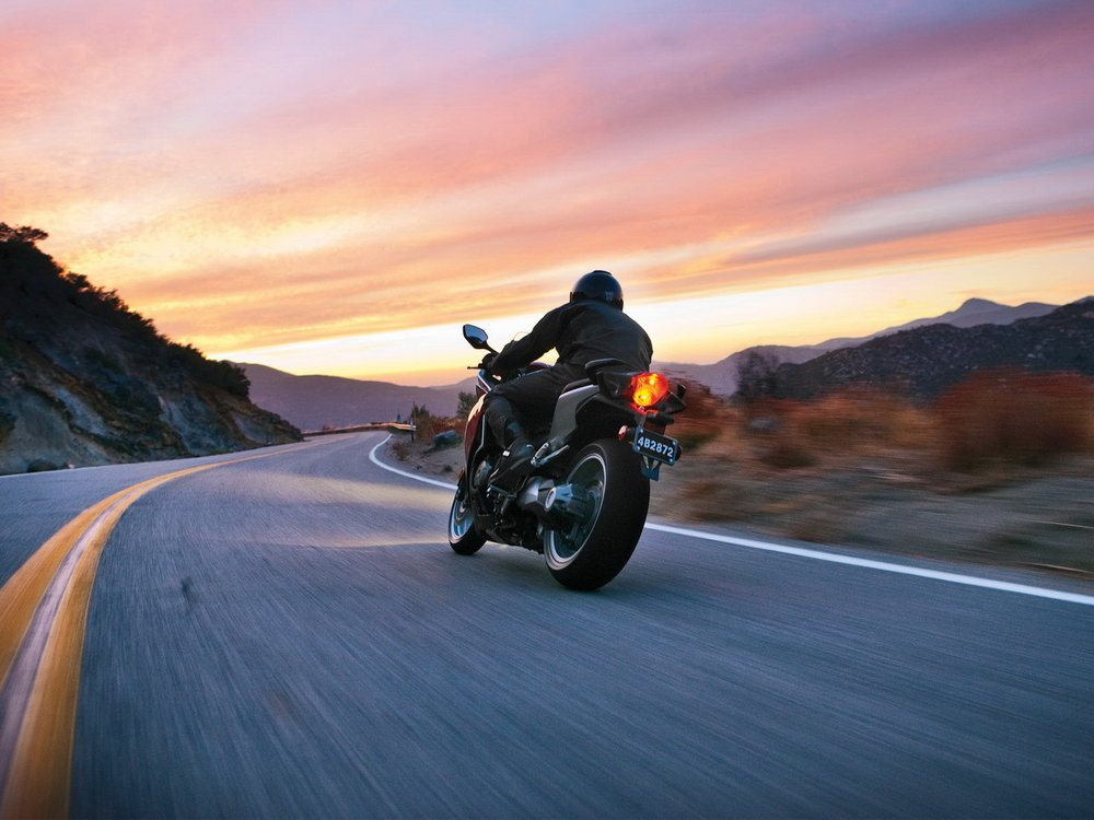 Biker riding towards the sunset