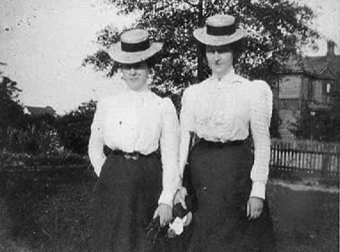 Unidentified ladies standing in Spratt White's front lawn with the Kimbrell's Boarding house shown in the background. Courtesy of the Pettus Library – Winthrop University