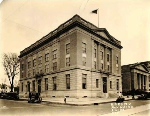 The second U.S. Post Office (at this location) and Federal Building, on the corner of East Main and Caldwell Street. The original building was moved to 325 South Oakland Avenue and became the Rock Hill Library.