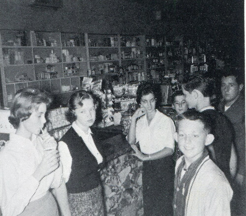 Teenagers hanging out at the soda fountain in Rogers Drug Store