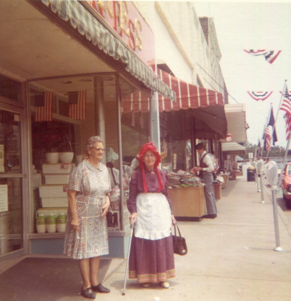 Ladies outside 221 Main during Centennial celebration