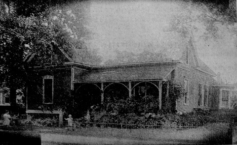 View of the historic Taylor - Kimball House where the Reid's Filling Station was constructed and later the home of South State Bank.