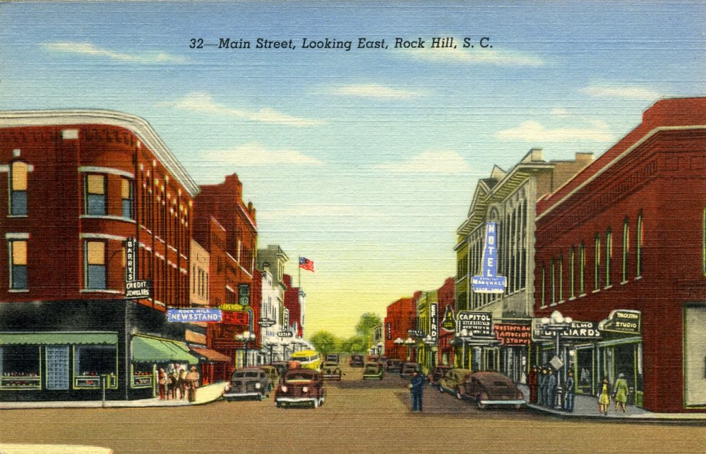 Postcard view of the corners of East Main and Trade Street. The Ratterree Drug Store and commercial complex was to the right on East Main and took in most of the Trade Street block west.