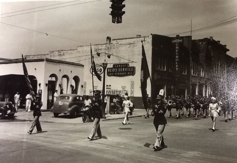 The corner of South Oakland and East Main Street became the popular Esso Station of Mr. Roddey Reid in much of the 20th century. Note the location of McFadden - Huey Motor (Chevrolet Co.), in the background.