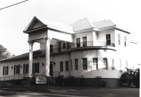 The Historic Flowers Home took up much of the corner of Elizabeth Lane and East Main Street. Bass Funeral home moved from their earlier location near the Andrew Jackson Hotel to operate for decades from the Flowers Home.