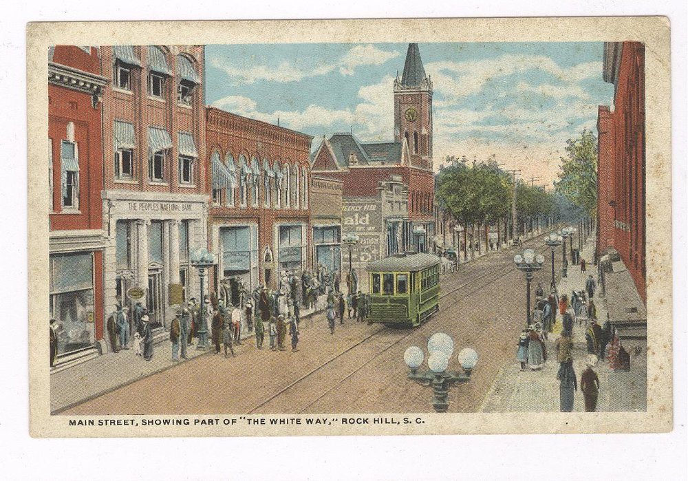 Note in this early 20th century postcard, St. John's Methodist Church's tower is clearly standing. In 1925 the church was demolished and the Citizens Bank was constructed on the corner location.