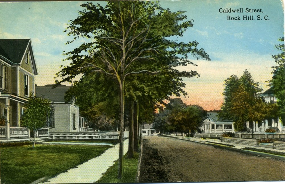 Historically Caldwell Street was a residential area which gradually evolved into the commercial area it is today. The first house  on the left was that of the Saint John's Methodist Minster, The Parsonage.