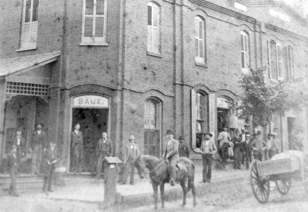 Men and horses in front of the Fort Mill town hall before it was destroyed by fire