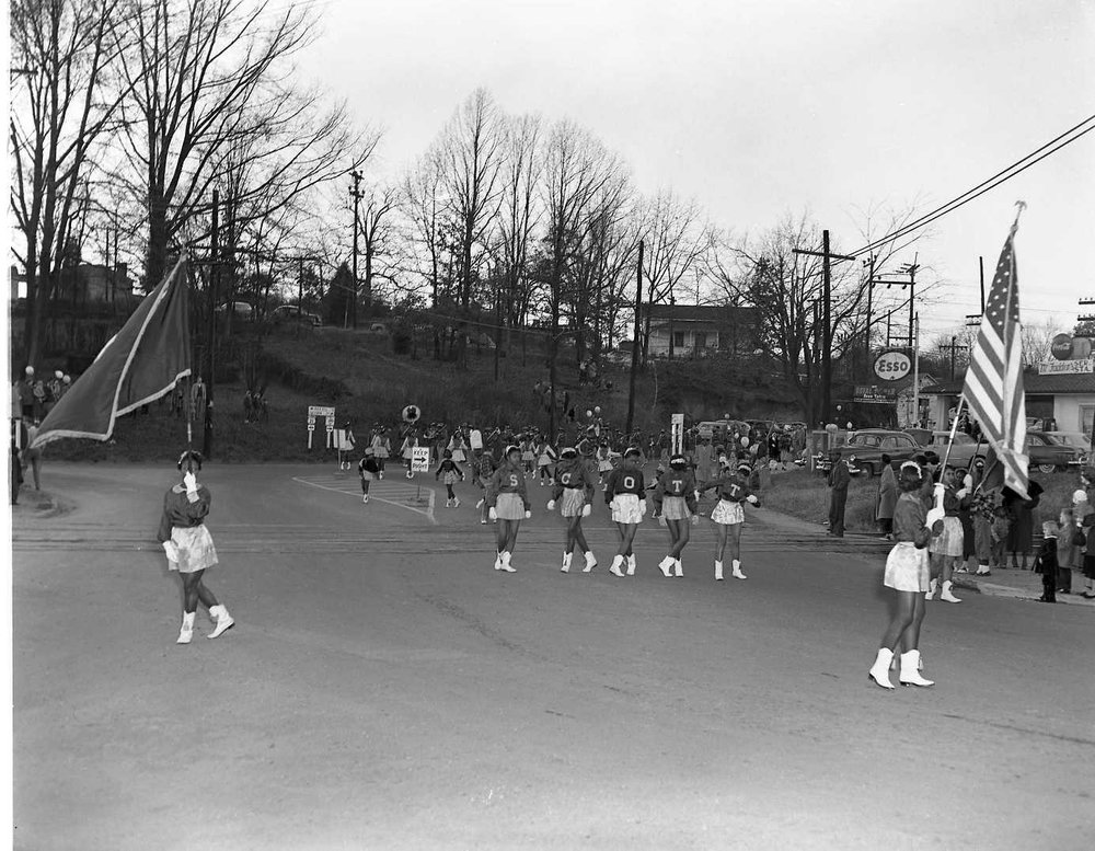 Christmas Parade with Esso station in the background