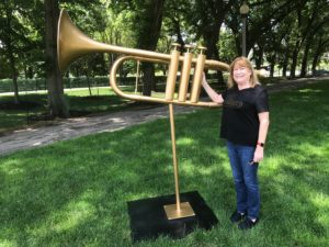Local fan, Mary, poses with the found trombone