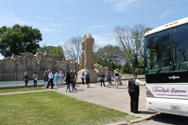 Bus tour visit to  Fountain of Time  in Washington Park. Photo by Elizabeth Cummings.
