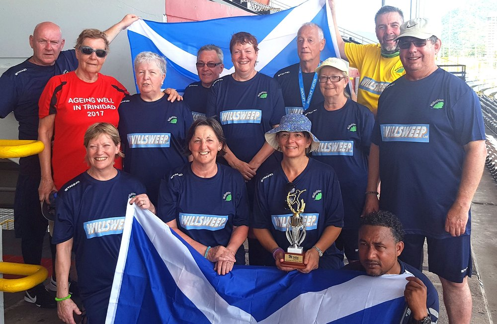 CaribbeanWinning team with cup.jpg