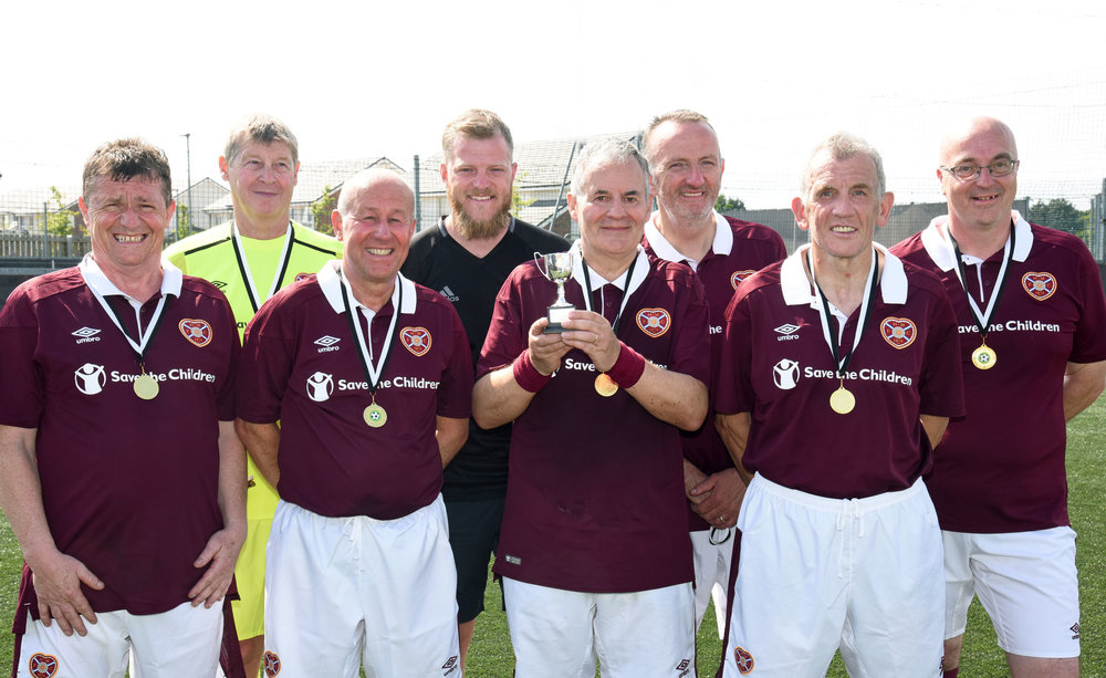 Heart of Midlothian captain Jimmy Bremner received the AUFA Trophy from Jason Butler.