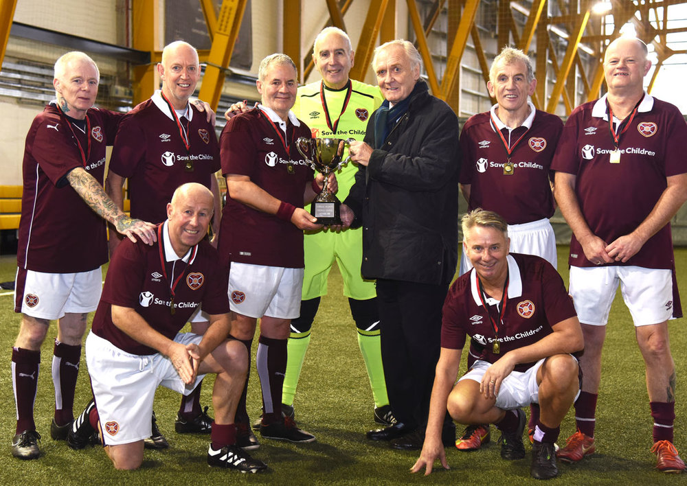 Football Legend David Hay presenting the victorious Hearts 56 team with the League Trophy today.
