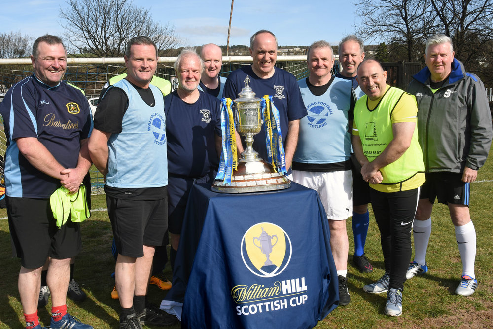 Some of the walking football players with the Scottish Cup