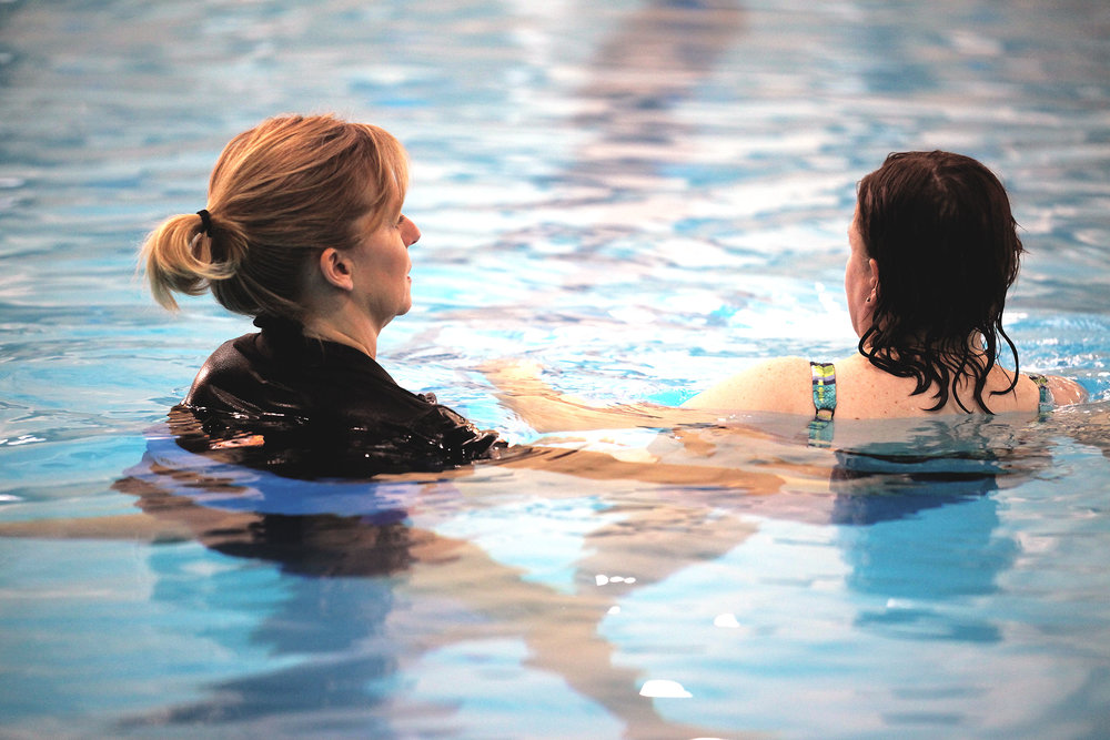 nancy-with-patient-in-pool.jpg