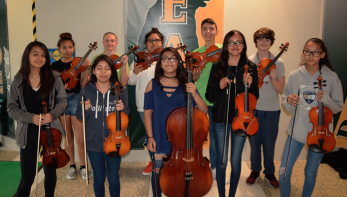 Members of the Omaha Bryan Middle School orchestra - the first group of instruments that were repaired by the OCMS Good Vibrations program.