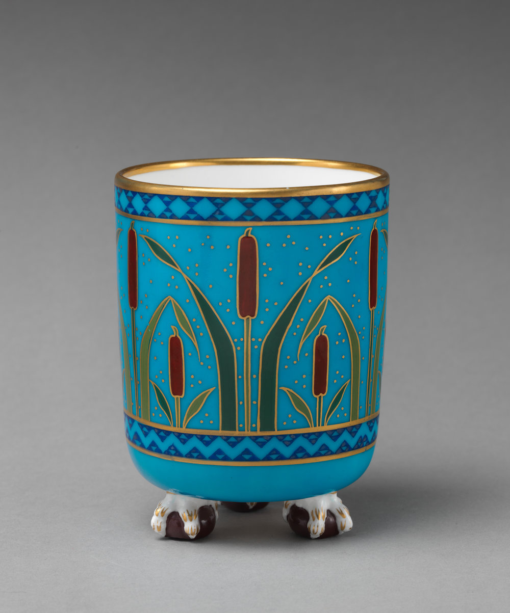 Cylindrical vase with cattail motif.  This bone china piece- created by Milton in the 1860's- features a cattail motif and is housed at The Metropolitan Museum of Art in NYC. Image in the Public domain and accessed  HERE .