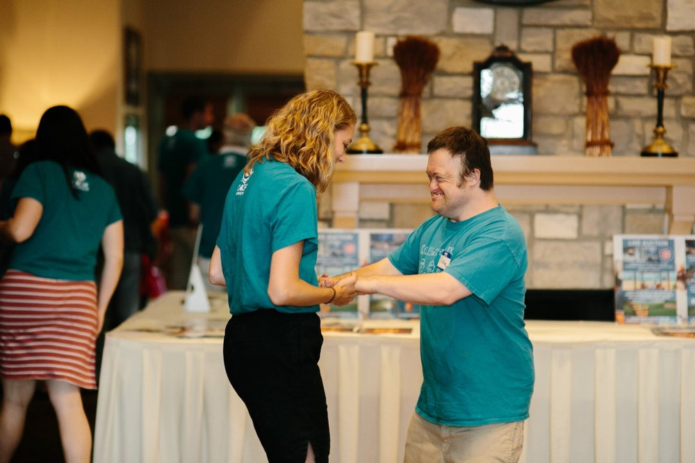 Sarah shares a moment with Elisha, a core member at Peace House, at the 2017 L'Arche Chicago golf outing.