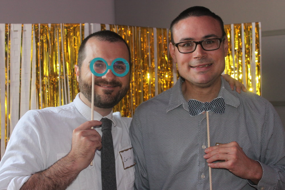 Peace House resident Carlo and Friendship House resident Tim enjoy the photobooth at last year's benefit and auction!