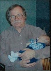 One of the last photos taken of my father, holding my nephew at Christmas 2004. Seven months before he passed away.
