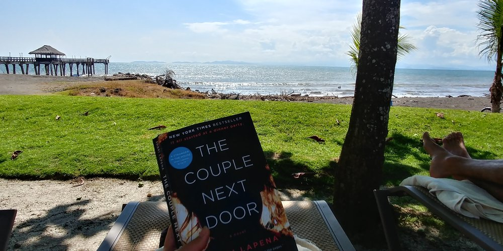 A little light reading while sunbathing on the beach in Puntarenas, Costa Rica.