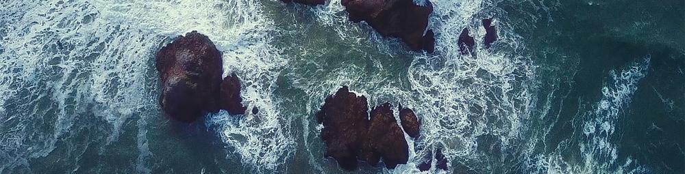 Ocean rocks, stormy.png