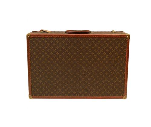 Suitcase by  Louis Vuitton