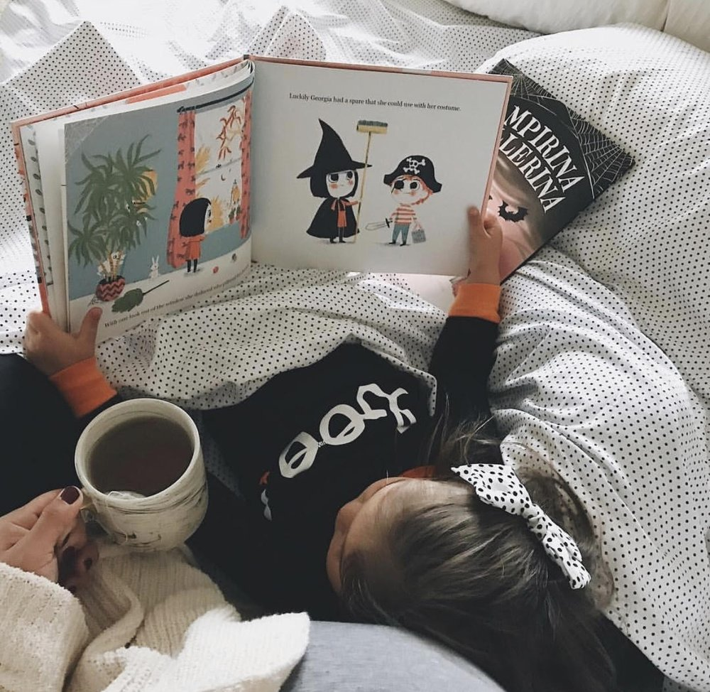 Spooky books and Halloween jammies  via Sarah Anderson