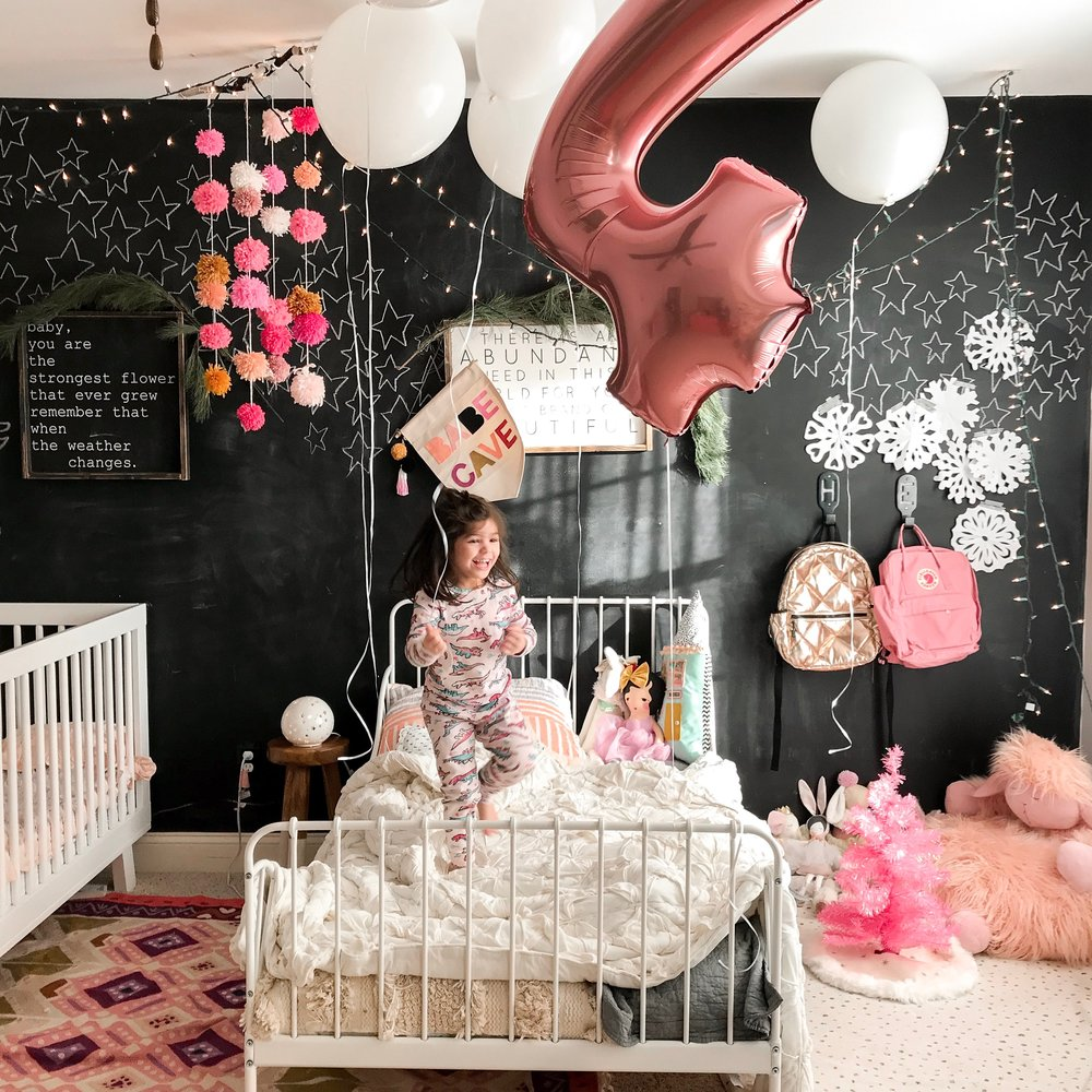 And here's our 4 year olds birthday dream come true. Waking up to balloons over her bed was magical! And we also add to our paper snowflakes collection each year too!